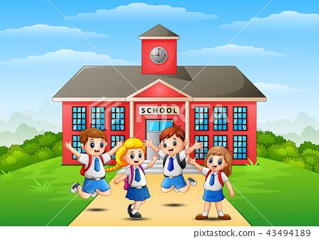 Happy school children in front of school building 43494189
