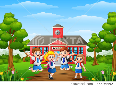 Happy school children in front of school building 43494492