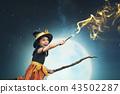 Beautiful asian witch girl using the magic wand 43502287