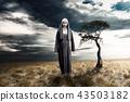 Scary devil nun with dark sky background 43503182