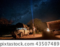 Traveler using flashlight crossing the milky way 43507489