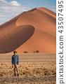 Male traveler standing in Namib desert, Namibia 43507495
