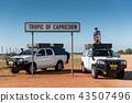 Man posing on camper car at tropic of capricorn 43507496