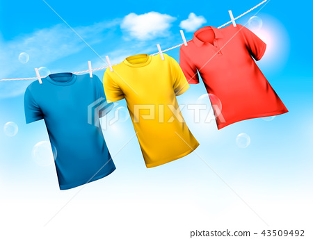 Three T-shirts hanging on rope against blue sky 43509492