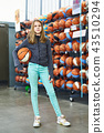 Girl with basketball in sport store 43510294