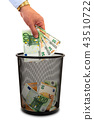 Throwing money away into the trash 43510722