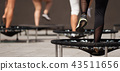 Fitness women jumping on small trampolines 43511656