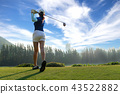 Asian woman golf player doing golf swing tee off  43522882