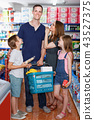 Family with two kids shopping in local supermarket with cart 43527375