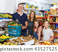 Family with two standing with cart of fresh fruits 43527525