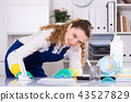 Cheerful female cleaning furniture 43527829
