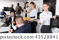 business people chatting while enjoying coffee 43528841