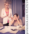 Mother scolds her adult daughter 43529214