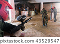 Paintball player targeting in opponents 43529547