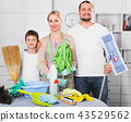 Family dressed for cleaning, standing 43529562