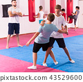 Kids practicing in pair self-protection 43529600