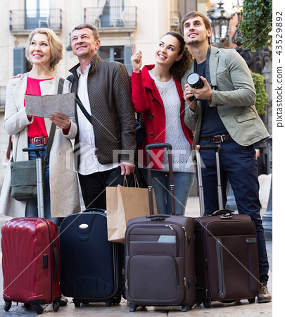 Portrait of tourists with map and baggage seeing the sights in European city 43529892
