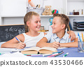Brother with sister are doing homework 43530466