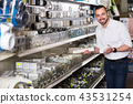 Man selecting electric socket 43531254