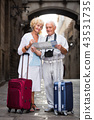 Senior woman and man traveling together looking for destination with city map 43531735