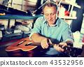 male, music, repairing 43532956