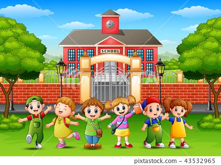 Happy school children standing in front of school  43532965