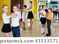 Little boys and girls having dancing class in classroom 43533571