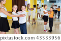 Little boys and girls having dancing class in classroom 43533956