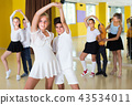 Positive kids are dancing twist in pairs 43534011