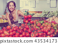 Glad young woman picking fresh tomatoes 43534173