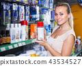 Portrait of female customer in household store 43534527