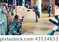 Teams faced on the battlefield in the arena of paintball. 43534633