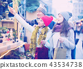 family of three with teenage girl choosing floral decorations at market. Shallow depth of focus 43534738