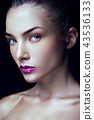 Close-up portrait of beautiful woman with bright make-up 43536133