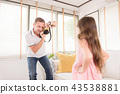 Kind dad is take a photo with his cute daughter. 43538881
