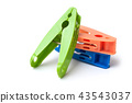 colorful plastic clothespins on white background 43543037