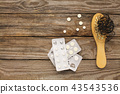 Fallen hair on comb and pill 43543536