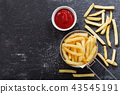 French fries with ketchup on dark table 43545191
