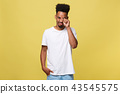 Closeup portrait man with sad expression, isolated on yellow wall background. Human emotions, body 43545575