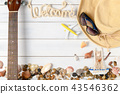 welcome text with hat, guitar and seashell 43546362