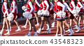 High school cheerleaders performing during game 43548323