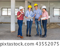 Multiethnic professional construction engineers working with Corporate Colleagues Teamwork and equipment blueprint at the building site place, Industrial engineering Concept 43552075