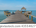 Wooden pier with boat in Phuket, Thailand.  43554627