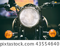 Close-up view of motorcycle headlight.  43554640