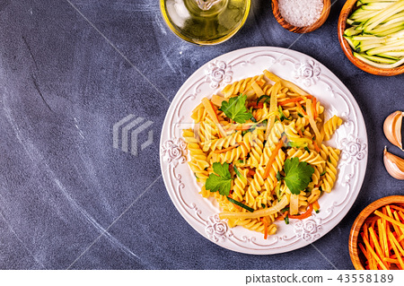 Fusilli pasta with squid, zucchini and carrots 43558189