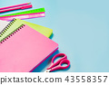 Colorful girlish school supplies, pens on blue. 43558357