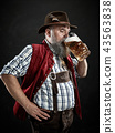 Germany, Bavaria, Upper Bavaria, man with beer dressed in in traditional Austrian or Bavarian 43563838