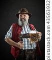 Germany, Bavaria, Upper Bavaria, man with beer dressed in in traditional Austrian or Bavarian 43563932