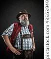 Germany, Bavaria, Upper Bavaria, man with beer dressed in in traditional Austrian or Bavarian 43563949