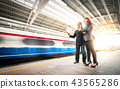 Business man and woman in train station 43565286